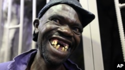 Mison Sere smiles after winning the 2015 edition of the Mr Ugly competition, in Harare, Nov. 21.2015.