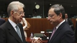 Italy's Prime Minister, Mario Monti,left, talks with President of the European Central Bank Mario Draghi, before a meeting of EU finance ministers in Brussels.