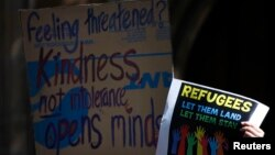 FILE - Protesters rally in central Sydney, Oct. 11, 2014, for refugees. A former Sudanese refugee has won one of Australia's highest civic awards.