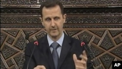 Syrian President Bashar al-Assad addresses the nation during a speech at the Parliament in Damascus, Syria, March 30, 2011