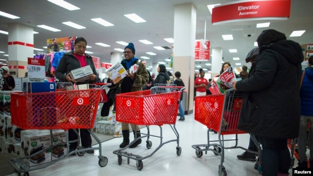 People shop inside a Target store during Black Friday sales in Brooklyn, New York, Nov. 29, 2013.