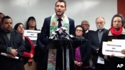 The Rev. Noel Andersen, center, from the Church World Service, condemns the alleged raids of Central American families with final order of deportation, on Tuesday, Dec. 29, 2015, at the headquarters of the Coalition for Humane Immigrant Rights of Los Angeles, in Los Angeles. Religious leaders and pro-immigration activists demanded president Barack Obama to stop the alleged raids. (AP Photo/Edwin Tamara)