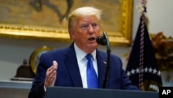特朗普总统在白宫罗斯福室举行的有关新冠病毒疫情期间食品供应链问题的一次活动期间讲话。(2020年5月19日)