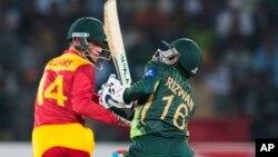 FILE: Zimbabwe's Sean Williams hits boundary as Pakistani wicketkeeper Mohammad Rizvan looks on during a match at the Gaddafi Stadium in Lahore, Pakistan, Sunday, May 24, 2015.