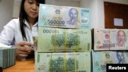 Theo phân tích mới nhất của Tiến sĩ Vũ Quang Việt,nợ của 3.200 doanh nghiệp nhà nước theo điều tra của Tổng cục Thống kê năm 2014 là 4,9 triệu tỉ đồng. (Ảnh minh hoạ)