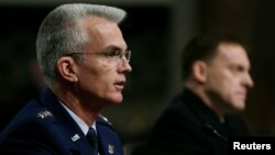 U.S. Navy Vice Admiral Michael Rogers (R) and U.S. Air Force General Paul Selva attend the Senate Armed Services Committee confirmation hearing on Capitol Hill in Washington, March 11, 2014.