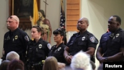 Police officers attend a church service after a fatal shooting of Baton Rouge policemen, at Saint John the Baptist Church in Zachary, Louisiana, July 17, 2016.