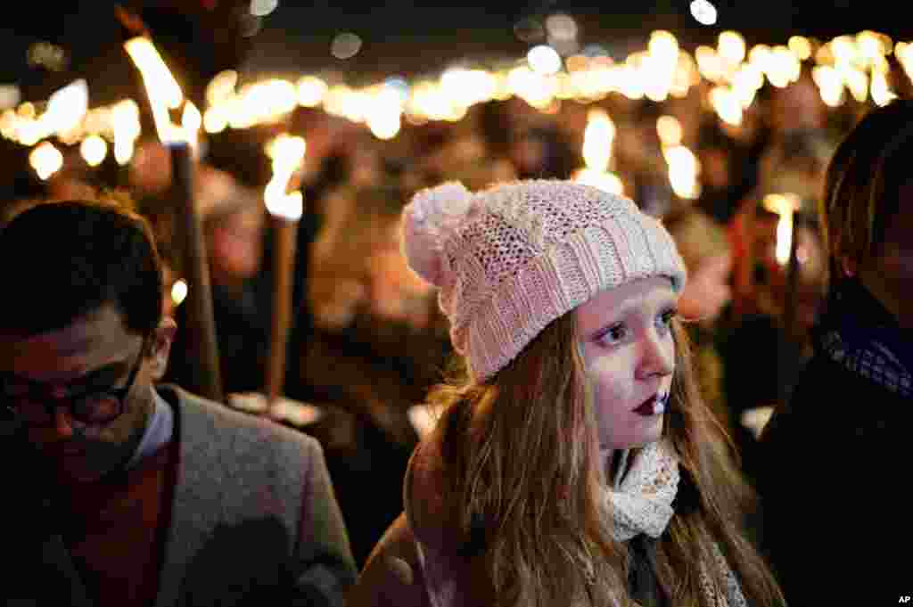Copenhagen residents hold torches as they gather Nov. 15. 2015, at Kongens Nytorv Square by the French Embassy in Denmark's capital to pay tribute to the victims of Friday's Paris attacks.