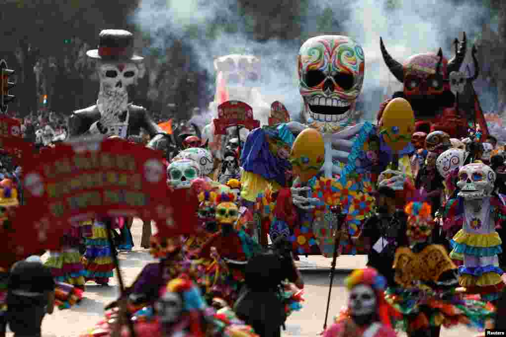 Skull figures are seen during a procession to commemorate Day of the Dead in Mexico City, Oct. 28, 2017.