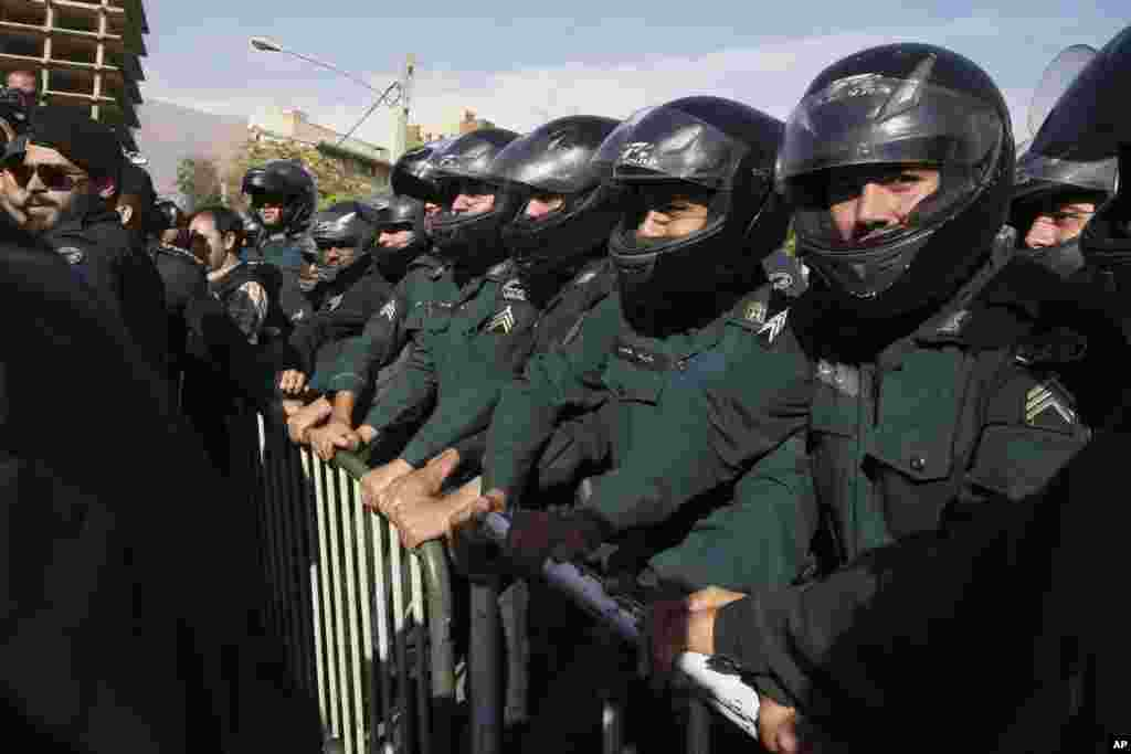Iranian police officers protect the embassy of Saudi Arabia in Tehran during a gathering of protesters who blame the country for a deadly stampede on Thursday that killed more than 700 pilgrims, Sept. 27, 2015.
