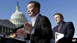 FILE - Rep. Chris Smith, R-N.J., right, listens as he and human rights activist Harry Wu, left, criticize the one-child rule in China, at the Capitol in Washington, Monday, March 7, 2011.