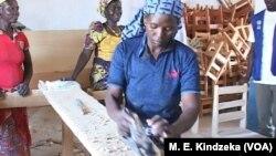 A Nigerian refugee carpenter at Minawao workshop.