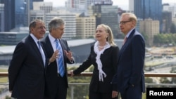 Australia's Foreign Minister Bob Carr (R) and Australian Defense Minister Stephen Smith (2nd L) talk with U.S. Secretary of State Hillary Clinton (2nd R) and U.S. Defense Secretary Leon Panetta (L) in Perth, Australia November 14, 2012.