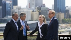 Australia's Foreign Minister Bob Carr (R) and Australian Defense Minister Stephen Smith (2nd L) talk with U.S. Secretary of State Hillary Clinton (2nd R) and U.S. Defense Secretary Leon Panetta (L) in Perth, November 14, 2012.