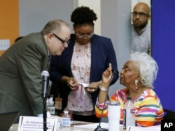 Brenda Snipes, Broward County supervisor of elections, right, speaks with officials before a canvassing board meeting Nov. 9, 2018, in Lauderhill, Fla. Florida will learn Saturday afternoon whether there will be recounts in the U.S. Senate race between Republican Gov. Rick Scott and incumbent Democrat Bill Nelson; and in the governor's race between former Republican U.S. Rep. Ron DeSantis and the Democratic mayor of Tallahassee, Andrew Gillum.