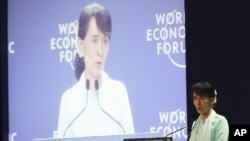 Burma's opposition leader Aung San Suu Kyi addresses the World Economic Forum on East Asia in Bangkok, Thailand, Friday, June 1, 2012.