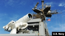 The U.S. Navy's Laser Weapons System (LaWS) is deployed aboard the USS Ponce in the Persian Gulf. LaWS is a collaborative effort between ONR, Naval Sea Systems Command, U.S. Naval Research Laboratory and NSWCDD. (U.S. Navy photo by John F. Williams)