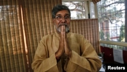 2014 Nobel Peace laureate Kailash Satyarthi speaks with the media in New Delhi, October 10, 2014.