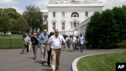 Members of the media, and others, are evacuated from the White House in Washington, June 9, 2015.