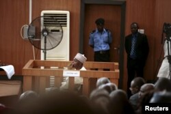 FILE - Nigeria's Senate President Bukola Saraki looks from the dock at the Code of Conduct Tribunal at Darki Biu, Jabi Abuja, Nigeria, Sept. 22, 2015.