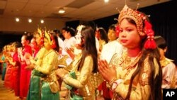 A group of young girls, performed a traditional Khmer dance, through the Buddhist Society's cultural program.
