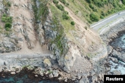 FILE - Landslides block State Highway One near Kaikoura on the upper east coast of New Zealand's South Island following an earthquake, Nov. 14, 2016. Facebook created maps after the earthquake to show where people were going in the days after the quake struck.
