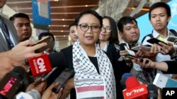 Wearing a Palestinian scarf, Indonesian Foreign Minister Retno Marsudi, center, talks to the media during Bali Democracy Forum held in Tangerang on the outskirts of Jakarta, Indonesia, Thursday, Dec. 7, 2017. Marsudi condemned the U.S. recognition of Jerusalem as the capital of Israel in her speech at the opening of the forum.