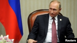 Russian President Vladimir Putin attends a meeting at the Asia-Pacific Economic Cooperation Summit in Lima, Peru, Nov. 19, 2016. In remarks made as part of a documentary film produced by American filmmaker Oliver Stone, Putin suggests Russia's annexation of Crimea from Ukraine was motivated by fear over the fate of Sevastopol, where Russia's Black Sea fleet is based.