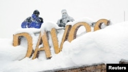 Snipers hold their position on the roof of a hotel during the World Economic Forum (WEF) annual meeting in the Swiss Alps resort of Davos, Switzerland, Jan. 22, 2018.