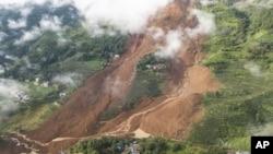Tanah longsor di Desa Pingdi, Kabupaten Shuicheng, Liupanshui, Provinsi Guizhou, Cina barat daya, Rabu 24 Juli 2019. (Tao Liang / Xinhua via AP)