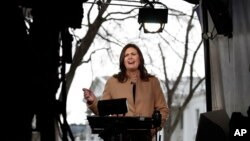 White House press secretary Sarah Huckabee Sanders speaks during a television interview outside the White House in Washington, Jan. 22, 2018, on the third day of the federal shutdown.