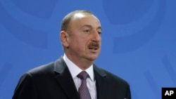 Rights groups accuse the government of Azerbaijan President Ilham Aliyev of launching a campaign to silence opposition since he was elected to a third presidential term in 2013.