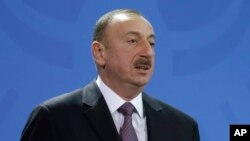 FILE - Azerbaijan President Ilham Aliyev announced an amnesty March 19 that resulted in the pardoning and release of two jailed opposition activists, yet some still say the country is bent on silencing critical voices.