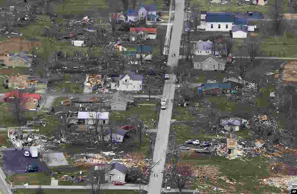 Several homes lie demolished next to other homes that were untouched, March 3, 2012, in Holton, Indiana, by a tornado that swept along the main street. (AP)