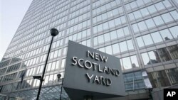 FILE - A view of New Scotland Yard, the headquarters building of the Metropolitan Police, with its sign in London, Dec. 20, 2010.