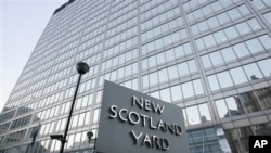 A view of New Scotland Yard, the headquarters building of the Metropolitan Police, with its sign in London, 20 Dec 2010.