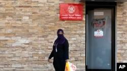 Une femme quittant une aire de service réservée aux femmes dans un restaurant à Djeddah, en Arabie Saoudite, le 8 décembre 2019.