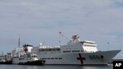 """FILE - Chinese navy hospital ship """"The Peace Ark"""" arrives at the port in la Guaira, Venezuela, Sept. 22, 2018."""