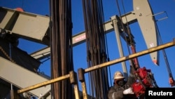 A man works on the rig of an oil drilling pump site. (File)