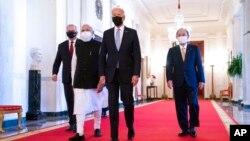 President Joe Biden walks to the Quad summit with, from left, Australian Prime Minister Scott Morrison, Indian Prime Minister Narendra Modi, and Japanese Prime Minister Yoshihide Suga, in the East Room of the White House, Sept. 24, 2021.