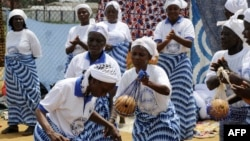 File - Members of the Women In Peacebuilding Network dance, sing and pray in anticipation of the nation soon being declared Ebola-free, in Monrovia, Liberia, May 2015.