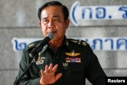 Thai Army chief General Prayuth Chan-ocha gestures during a news conference at the Thai Army Club after the army declared martial law nationwide to restore order in Bangkok, Thailand, May 20, 2014.