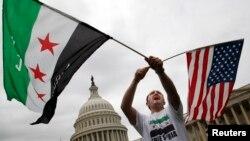 Jehad Sibai dari Michigan salah satu peserta Rally Suriah -Amerika melakukan protes di depan gedung kongres AS menentang aksi militer AS ke Suriah (9/9/2013)