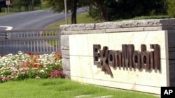FILE - A sign marks the entrance of the Exxon Mobil cooperate headquarters in Irving, Texas, Oct. 30, 2003.