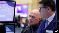 Specialists John O'hara, left, and David Haubner work on the floor of the New York Stock Exchange, Nov. 15, 2016.