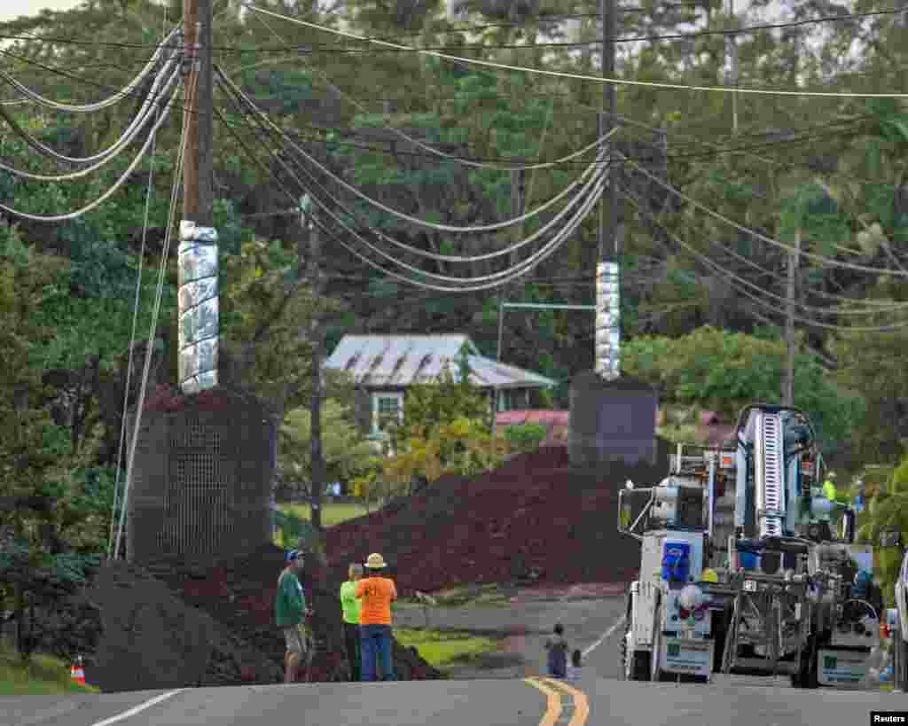 Construction crews prepare Pahoa Village Road as lava flow from Mt. Kilauea approaches the village of Pahoa, Hawaii, Oct. 28, 2014.