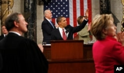 resident Barack Obama waves to First Lady Michelle Obama before 2009 speech to Congress.