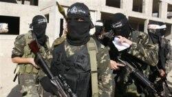 تظاهرات ستیزه جویان جهاد اسلامی و سنگ پرانی فلسطینیها در سالگرد جنگ غزه