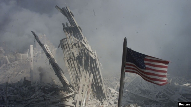An American flag flies near the base of the destroyed World Trade Center in New York, in this file photo from September 11, 2001,