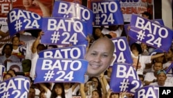 "Supporters raise their posters to cheer their senatorial candidate, former national police chief Rogelio ""Bato"" Dela Rosa during the last campaign rally by the administration for the midterm elections in suburban Pasig city east of Manila, Philippines, Ma"